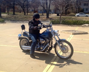 Photo of me seated on our motorcycle