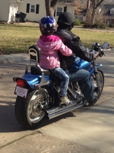 Photo of me and my daughter riding the motorcycle