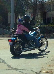 Photo of Laurel and kiddo riding the motorcycle